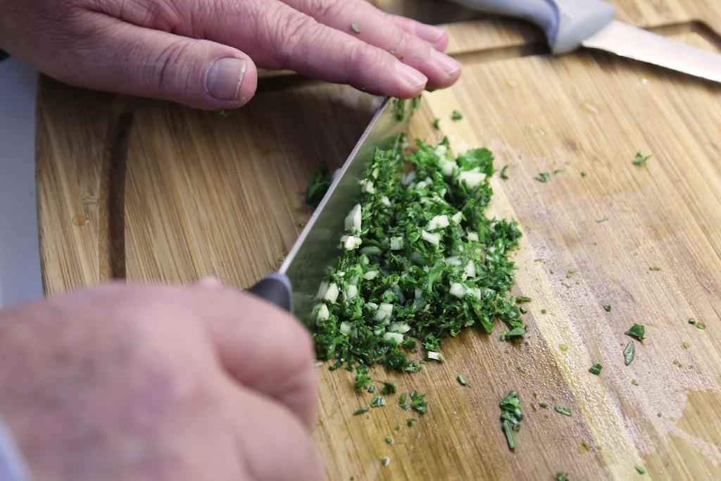 Dad chopping herbs and garlic