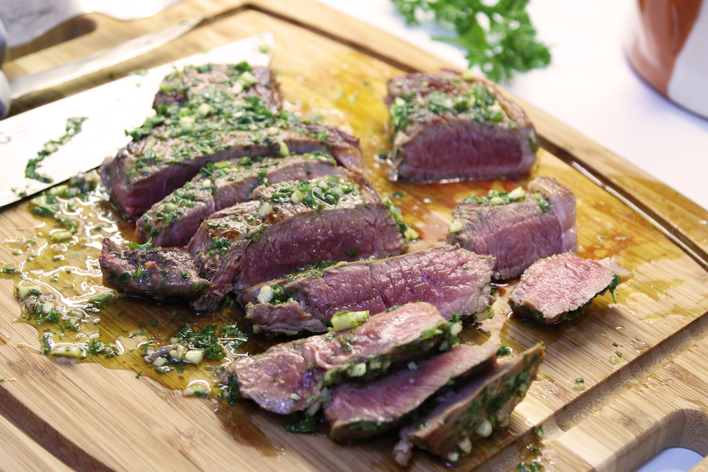 Slice steak and herbs