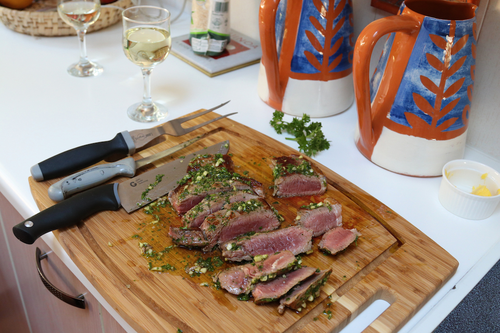 Steak and herbs and wine