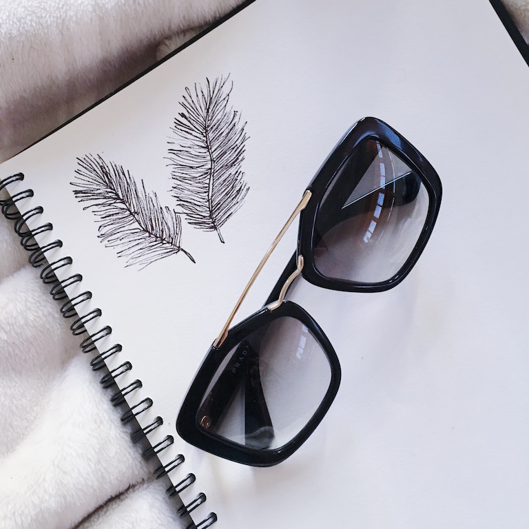 Feather doodles and Prada sunglasses